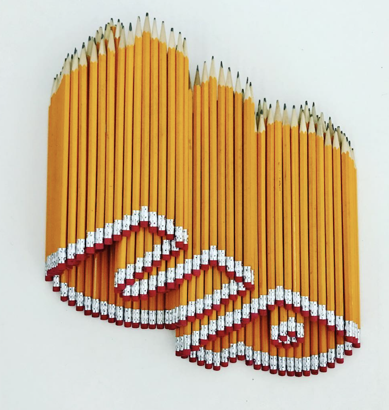 up made from yellow HB hexagon pencils sculpture.png