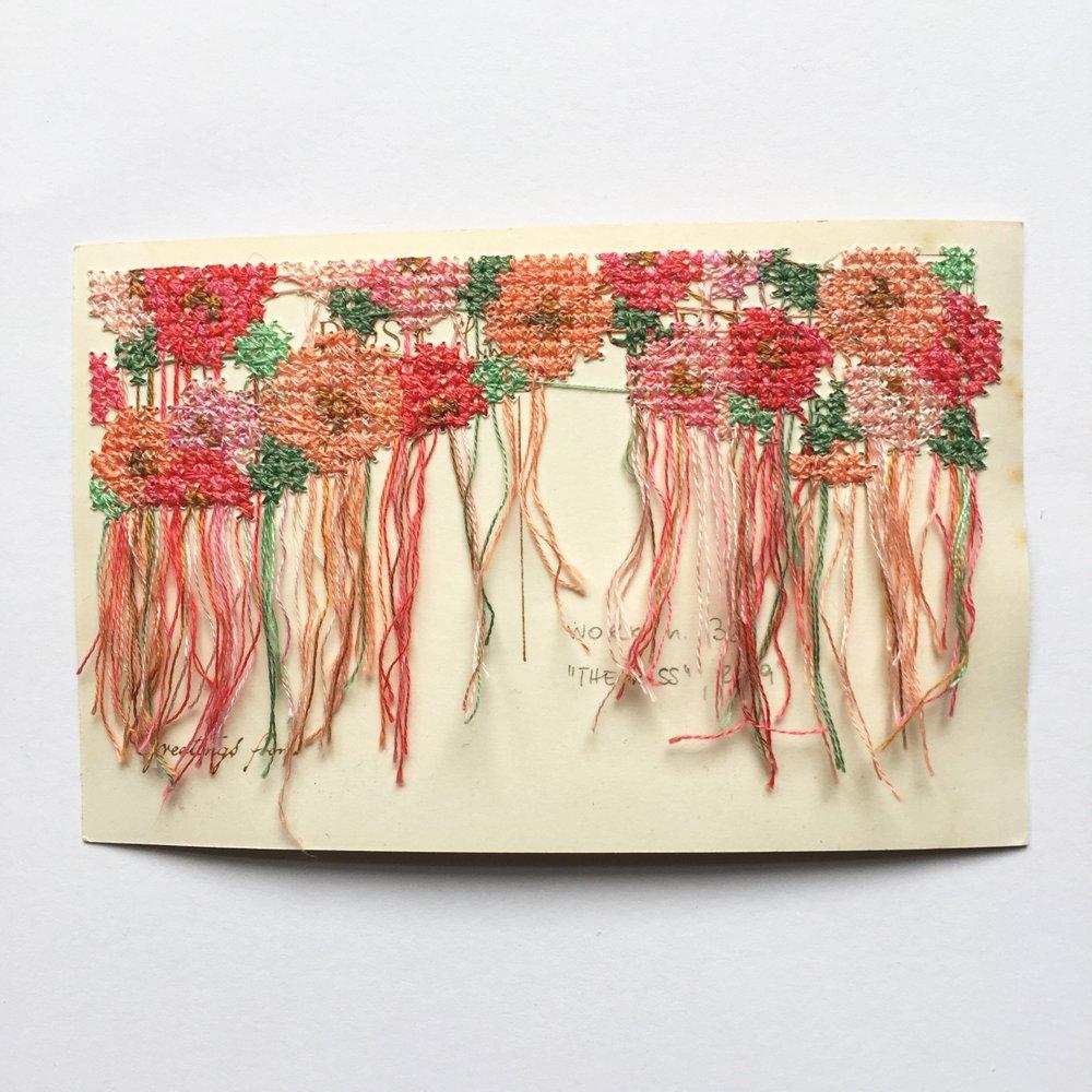 Floral cross stitch embroidery back on vintage postcard.JPG