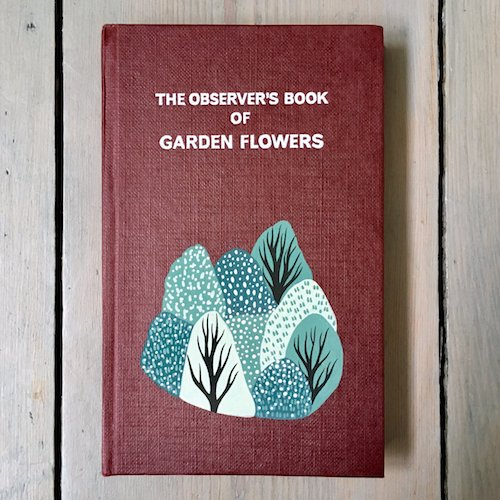 cute customised vintage book cover on garden flowers
