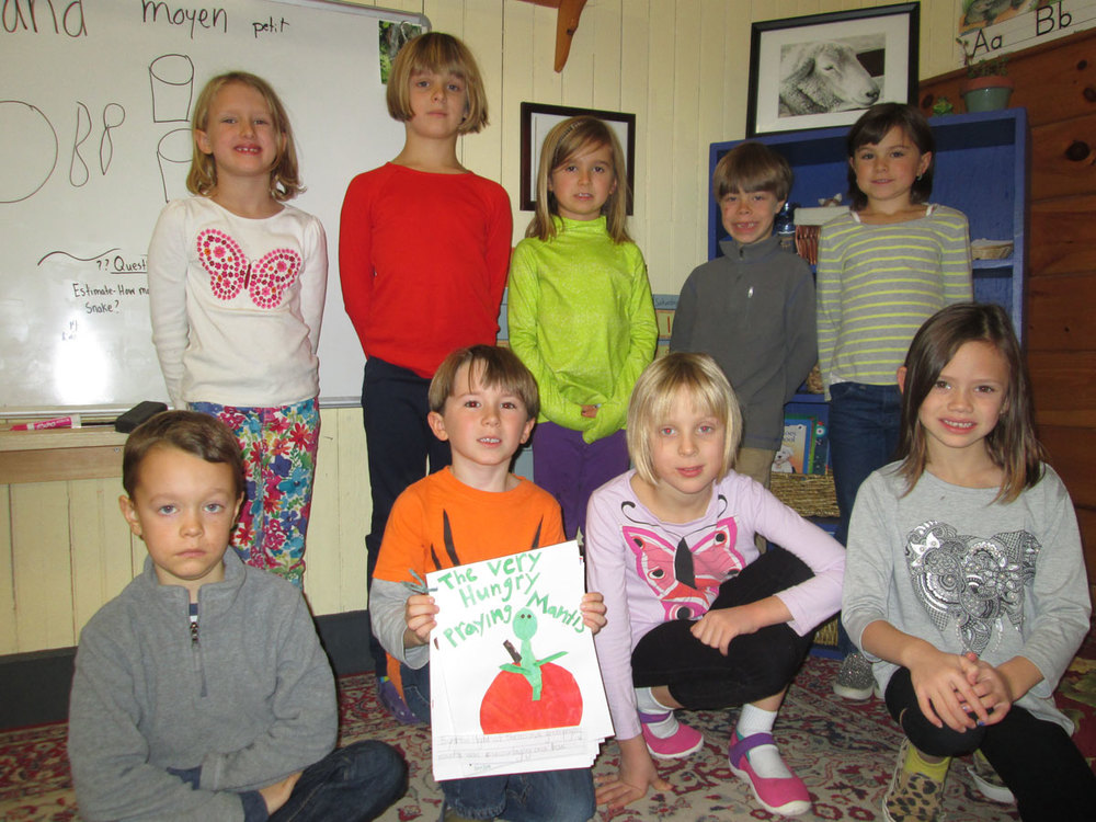 "Some members of the First Grade Class present their original story of ""The Very Hungry Praying Mantis"" - inspired by the writing and cut paper collage style of artwork found in Eric Carle's well-known and beloved children's books."