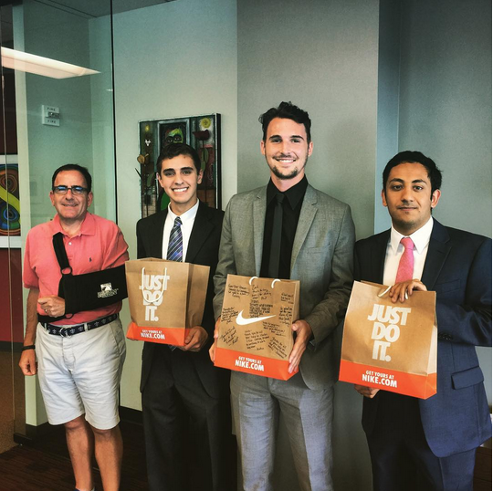 Summer 2015 interns with their last day swag