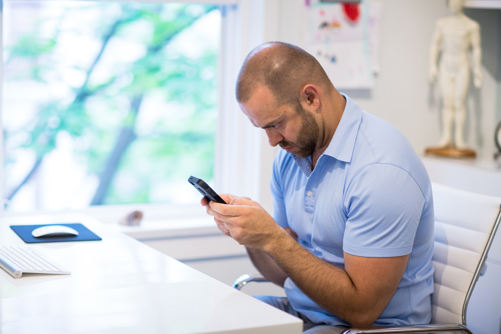 DON'T:  Using your mobile phone while at your desk often makes you round your shoulders, tighten your neck muscles, strain your eyes and is just BAD!