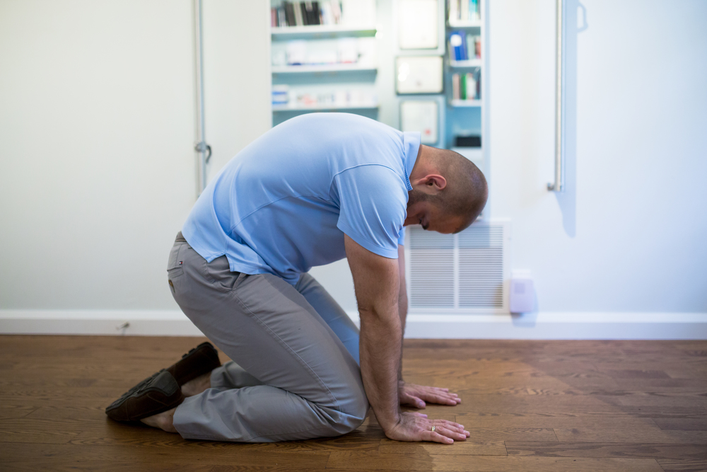 STEP 2:  As you start to exhale, begin arching your spine and push your body away from your hands and knees as you tighten your abdominal muscles. Breath in and repeat Step 1. Continue moving between these two positions for a few minutes.