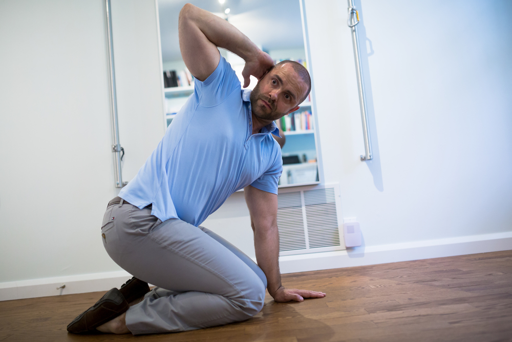 STEP 3:  As you start to inhale, begin rotating towards the right and arch upwards. Try to keep your pelvis at the same position. Make certain you do not push down on your neck and head. Rotate as far as you can go with good form.