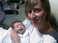 Here is Sadie holding her first daughter, Eva, in the NICU.