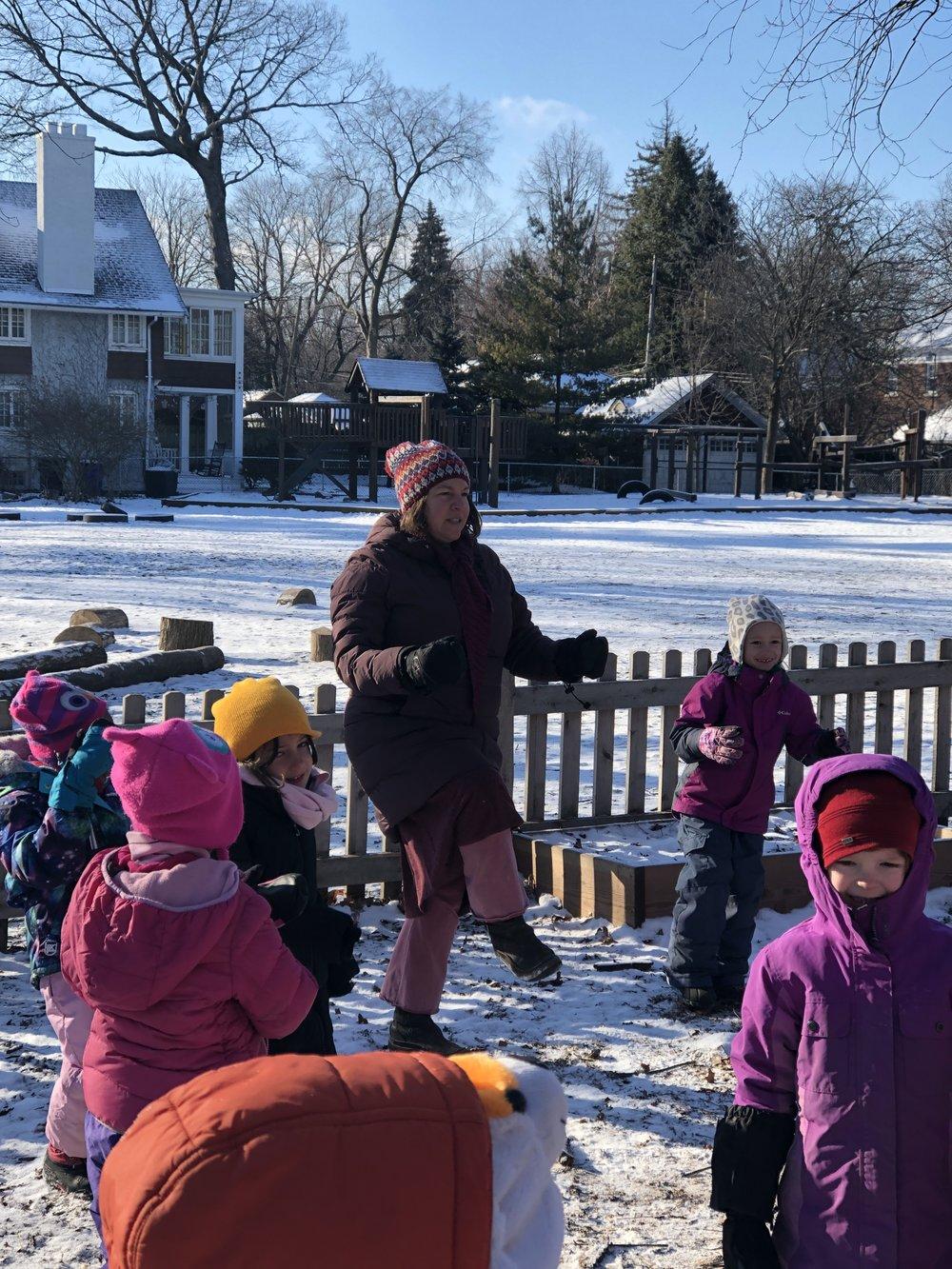 Rachel White, DWS Kindergarten Teacher, engaging her class in outdoor play.