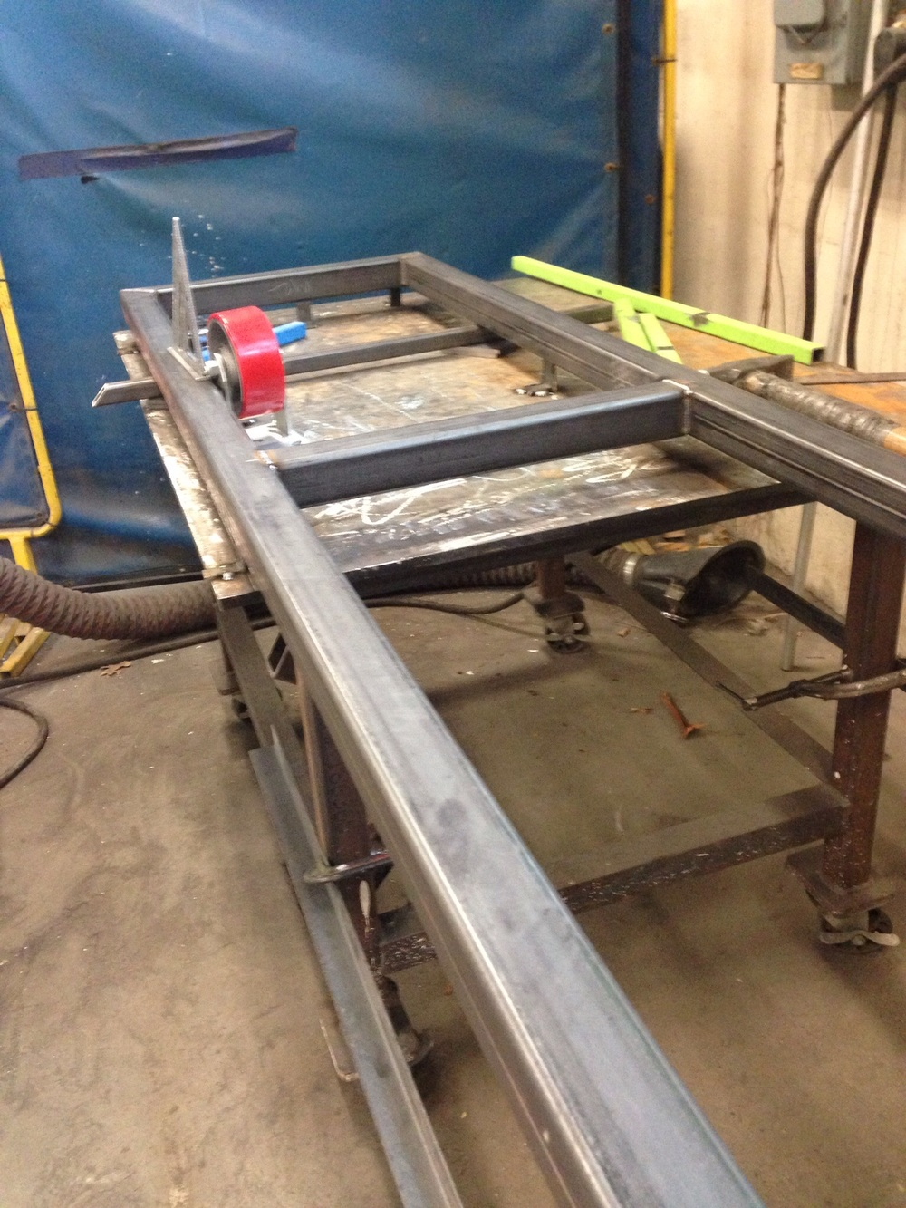 The frames for the moveable walls. I built a jig using two tables by clamping them together. Metal tabs were temporarily welded to hold the framework into place while they were welded.