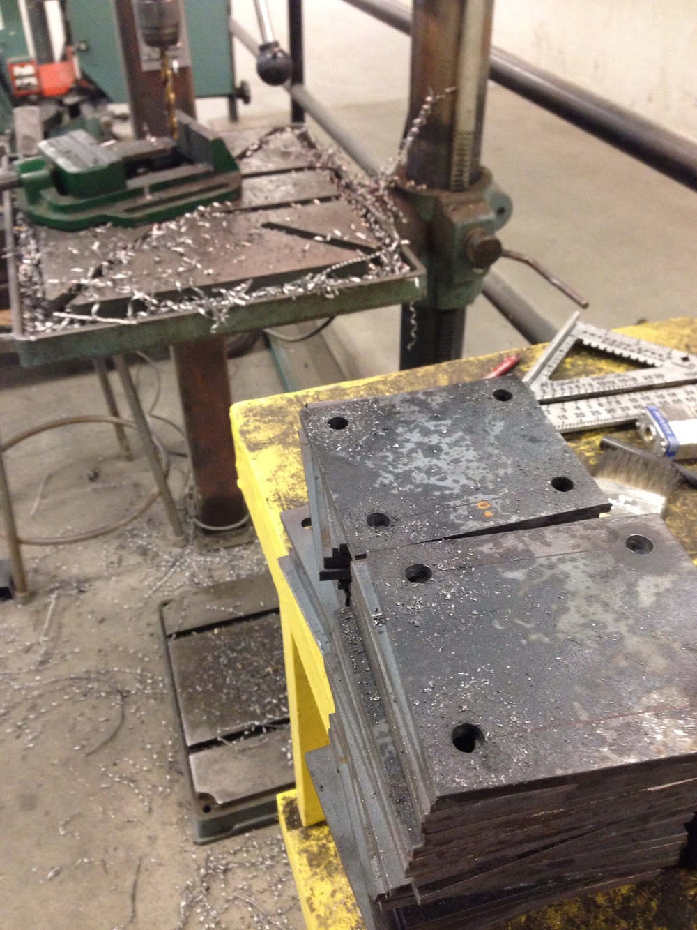 Plates cut and drilled for the casters.