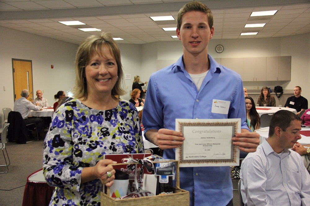 Jimmy Soderberg accepting the Tom and Irene Wilson Memorial Scholarship at a PTECH luncheon in May. Pictured with Deb Pence of the Idaho PTECH Network.