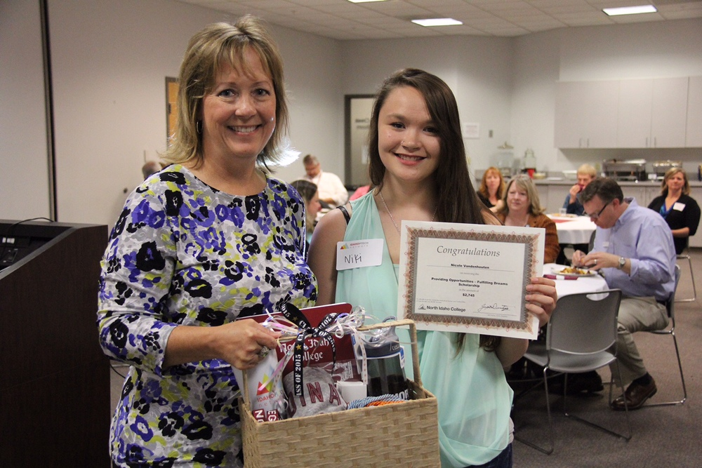 Niki accepting the Providing Opportunities - Fulfilling Dreams Scholarship at a recent PTECH luncheon at NIC. Pictured with Deb Pence of the Idaho PTECH Network.