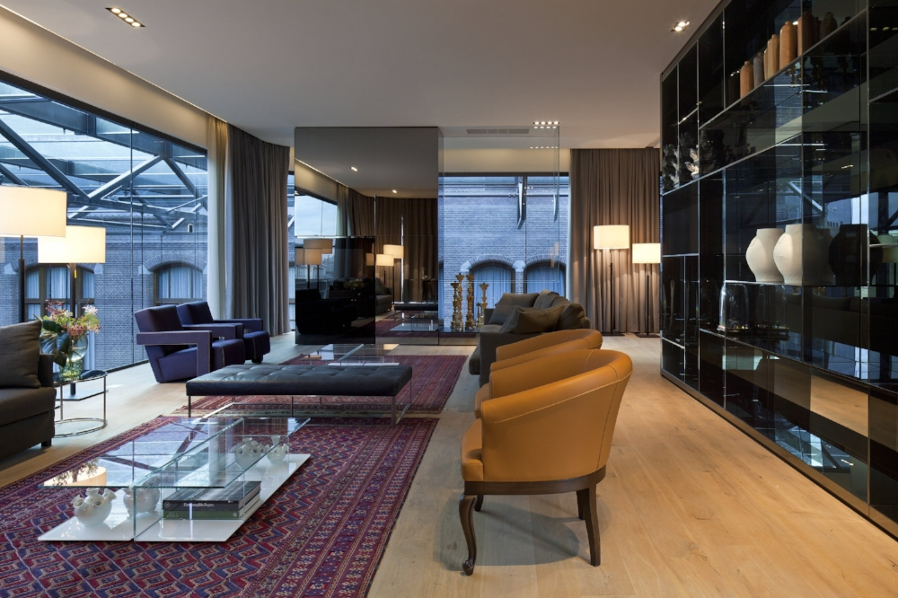The Crown Jewel of the Netherlands - The largest of the signature suites, the 170 square meter Penthouse is a single-story, loft-style eyrie with floor-to-ceiling windows around the entire suite. With most of the internal walls constructed by thick glass, the penthouse feels exceptionally large and spacious. From this perch atop the hotel's atrium, guests can look down on the hotel's lobby and lounge, or out across Amsterdam's rooftops and beyond. The Penthouse's large, 80-inch monitor screen in the dining room can also be used as a private cinema or entertainment area, while the suite also offers a kitchenette and a treatment area.