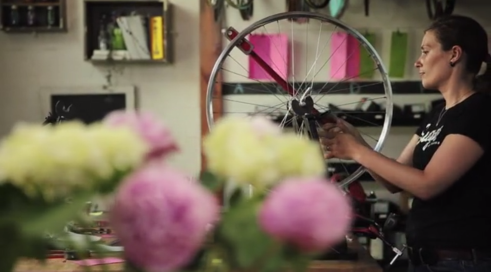 She builds bicycle wheels by hand!