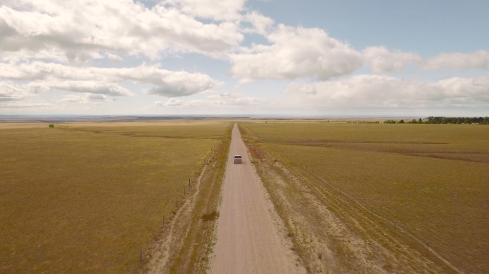 A drone shot captures the spirit of the open road. License this clip from Capture  here.