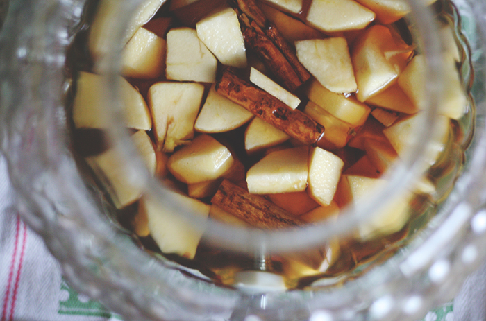 Drop in the chopped apples. Finish off with a few more cinnamon sticks, stirring well to ensure apples and cinnamon sticks are completely covered in the whiskey.