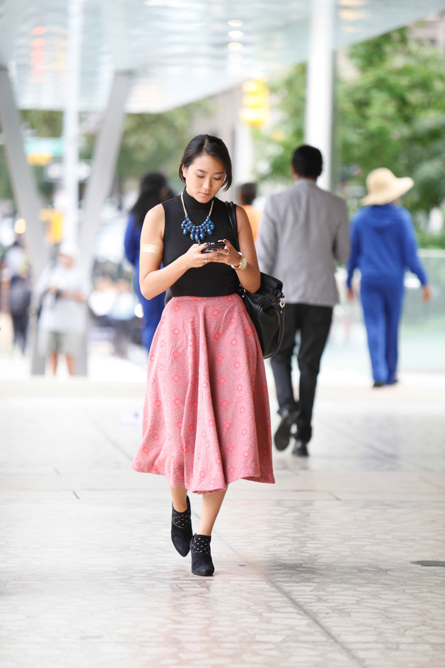 Lady-like with an edge. If midi skirts are too cutesy for your liking pair one with your favorite leather boots and you've gone from classy to sassy.