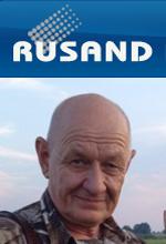 Jurek Rusand pic with logo