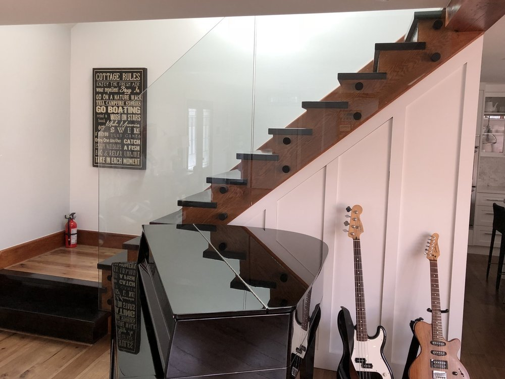 Standoff System - The Doors and More Stand Off glass railings system is without a doubt our most elegant and classy look of all. The glass appears to be floating giving your staircase a look as if there was no glass at all.