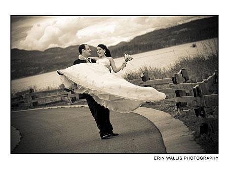 A groom swings his bride around