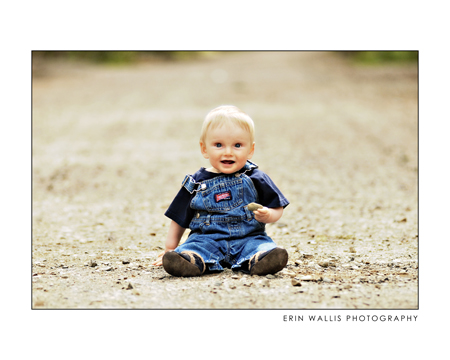 baby sitting on a dirt road