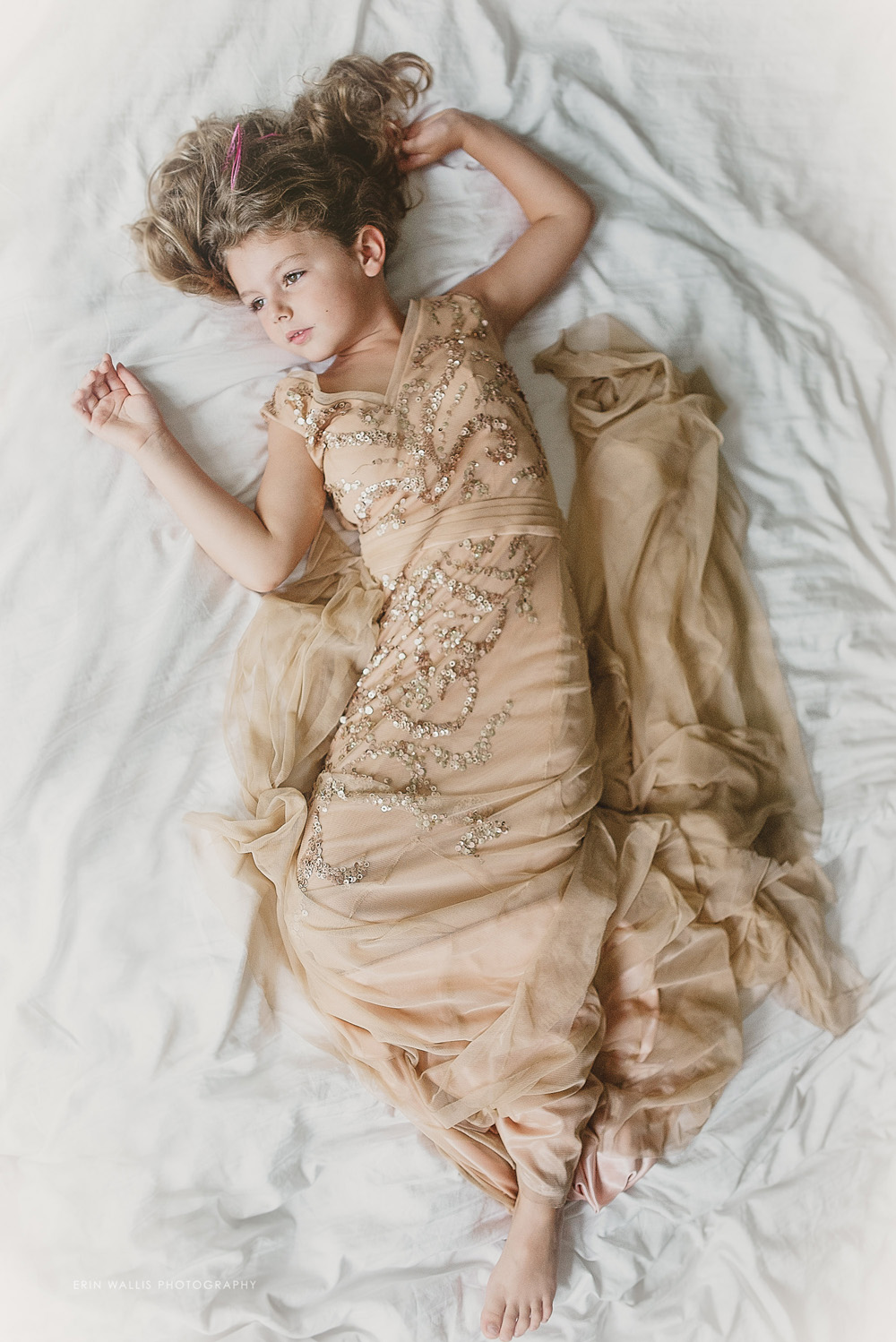 little girl in moms wedding dress