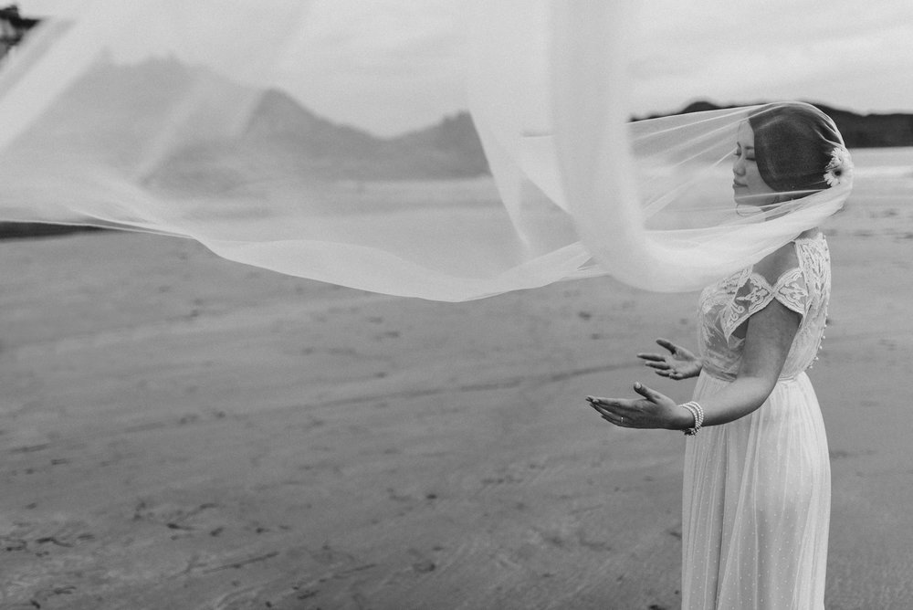 bride with veil in wind