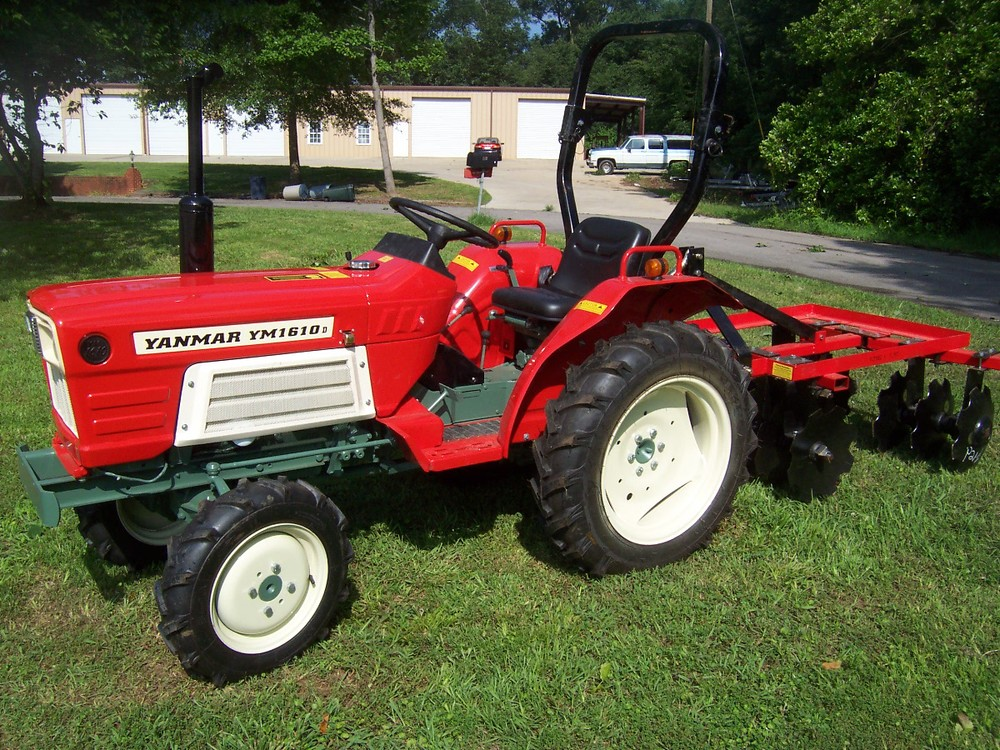 Yanmar YM 1610D  19 hp, 3 cylinder diesel, 4wd, powershift transmission with ROPS (roll over protective structure). Built in 1980 and 1981.  (Shown here with optional disc harrow.)   $6,199