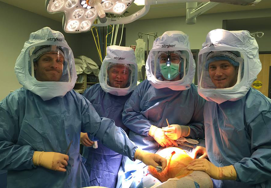 Pictured (left to right):  Operation Walk volunteers   Jordan McQueen,   Keithe Jones,   Jordan Schaeffer, and   Trevor Magee ready for surgery.