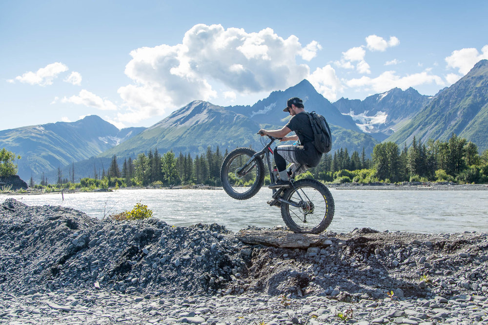 Noah rides a wheelie near Resurrection River - Seward, Alaska.