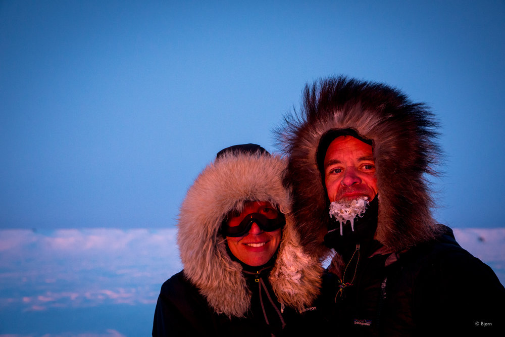 Bjørn and Kim pause for a rosy sunset on a 2016 fat-bike expedition from Nome to Kivalina.