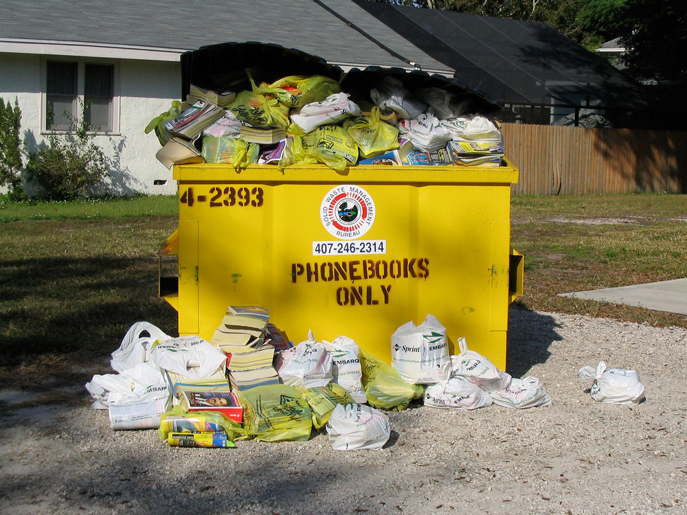 "Photo credit: ""Phonebooks galore"" by Tim Welch is licensed under CC BY 2.0."