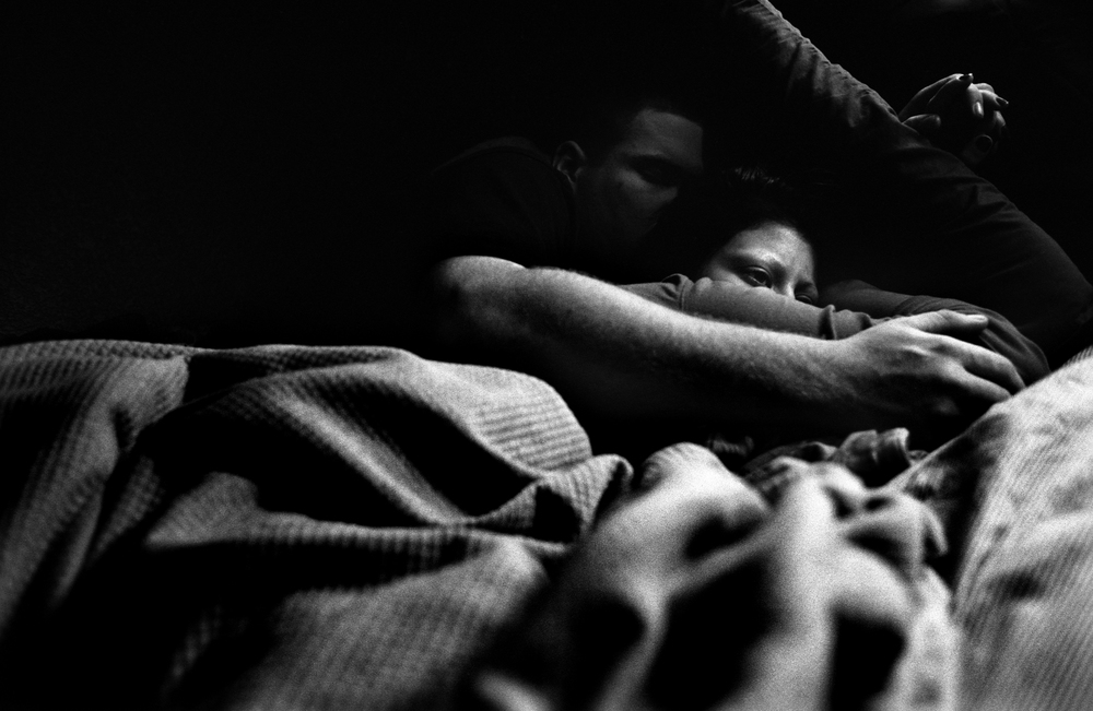SPC Adam Ramsey lies in bed with friend, Savannah Gordon, after taking opioids at his sister's house in Carson City, Nevada, 2010.