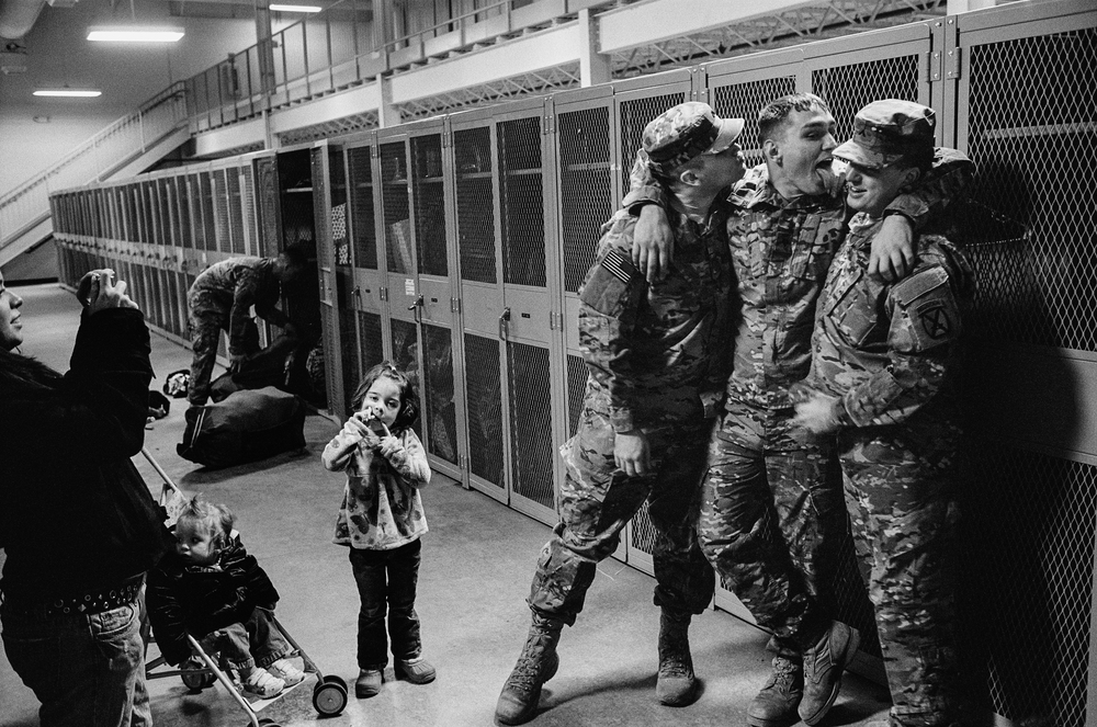Soldiers pose for pictures before they deploy to Afghanistan at Fort Drum, New York, 2011.