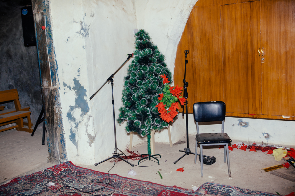 A Christmas tree at St. George's Chaldean church in the village of Baqofah, which was abandoned after it was attacked by ISIS militants. Northern Iraqi Kurdistan.