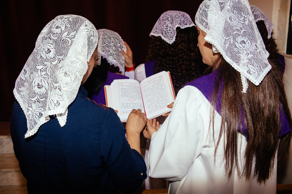 Girls sing in a choir during Catholic mass at church in Dohuk, Northern Iraqi Kurdistan.