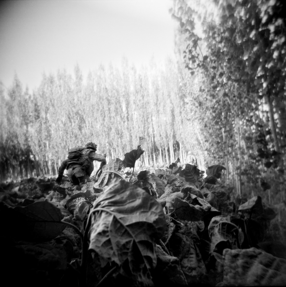 A soldier engages in a firefight while on patrol in Logar Province.
