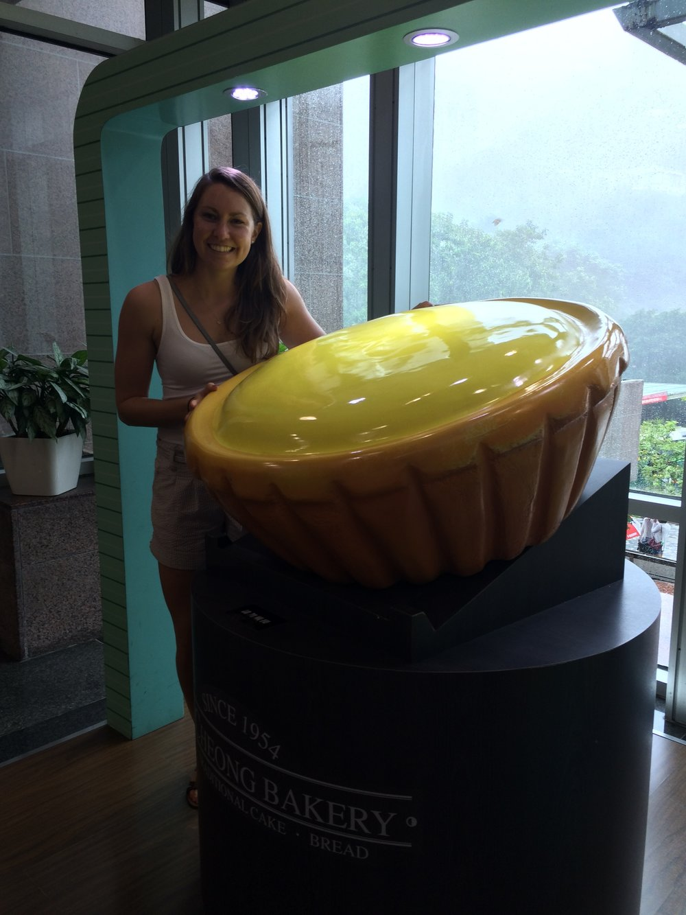 Super excited about a giant egg tart in Hong Kong.