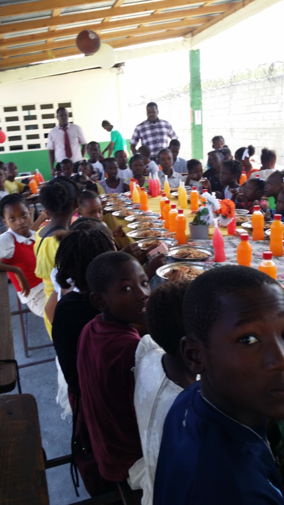 A special Christmas meal was provided for the students of the Becky DeWine Schools in Cite Soleil