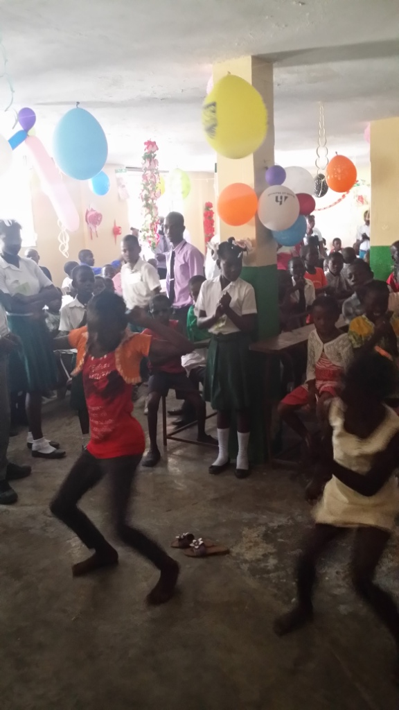 Students dancing during our Christmas celebration in Cite Soleil