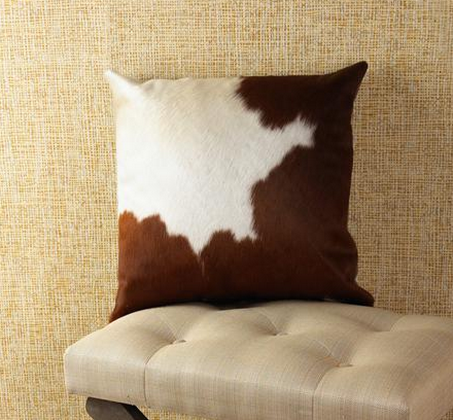 http://www.shadesoflight.com/brown-white-cowhide_pillow.html?&variantID=587770&gclid=CPLUxPCk5MICFczm7AodY0wANg