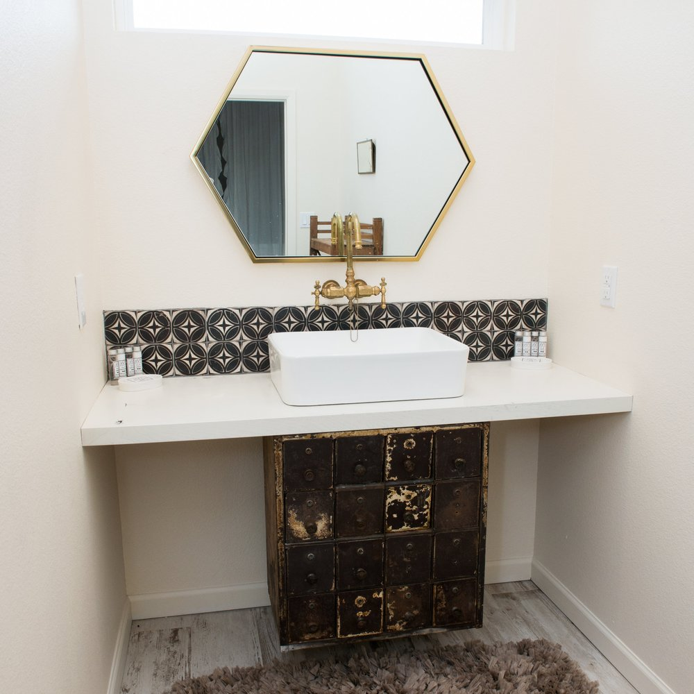 Jonathan Dahl Woodworks - Our good friend Jon created beautiful custom cabinetry in the kitchen, along with a custom vanity in the Guest Bathroom. He even retro-fitted these awesome drawers for the vanity in the Additional Bathroom.