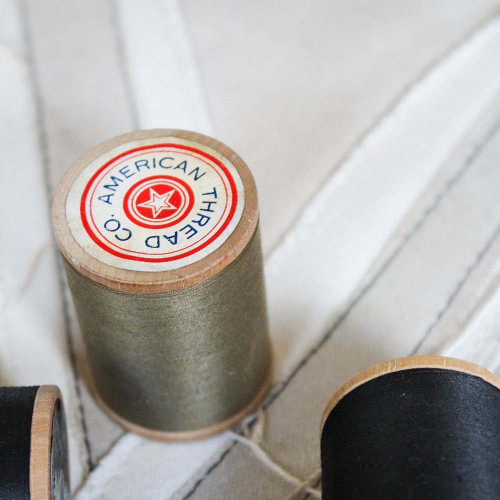 Thread Spools - $9 | A set of 3 black American Thread Co. spools or 3 army green American Thread Co. spools that came from the Schudde Bro Hat company in Houston, Texas. Spools are unused and coloring is vibrant and pristine.