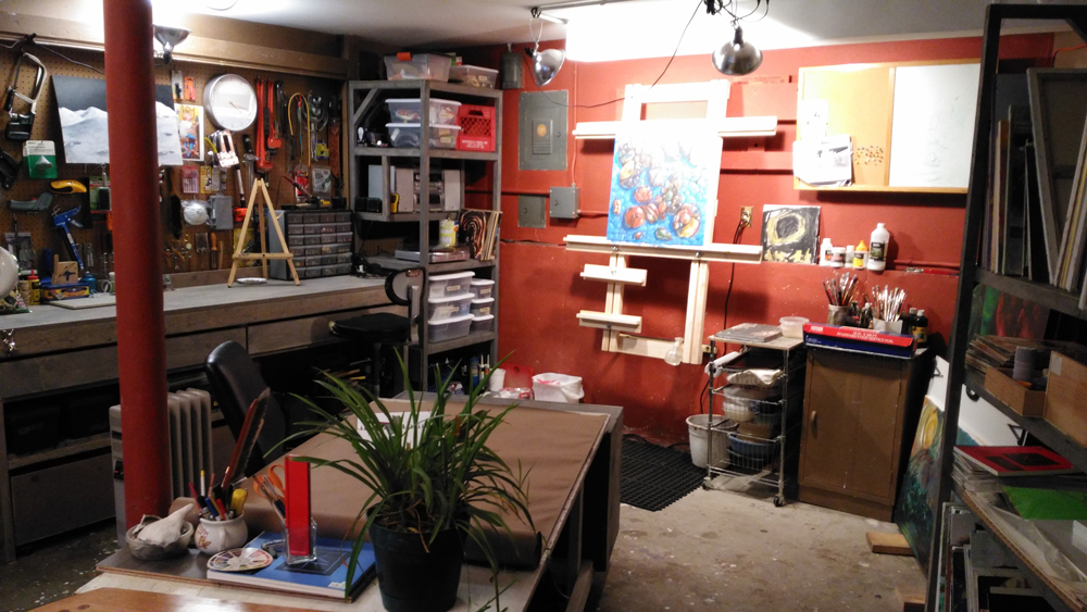 One side of the new studio showing new workbench, shelves and painting storage, and a new easel.