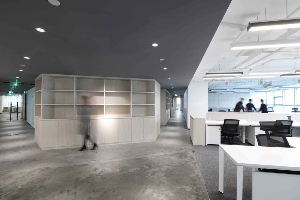 A multifunctional plywood wall wraps around the central core, connecting the different departments together and providing pin up walls, seating, and display areas, as well as discreet storage for coats and files. Open meeting rooms, closely connected with both breakout spaces and work clusters reinforce the informal approach to workplace design.