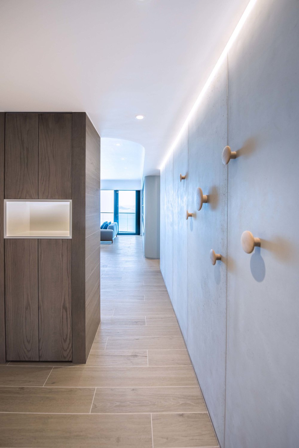 The concrete panels used in the project were prefabricated from France which could be easily cut and assembled quickly, cutting down on site construction time. A long continuous LED light strip accentuate the concrete panels, controlled by the overall scene lighting control system for the apartment.