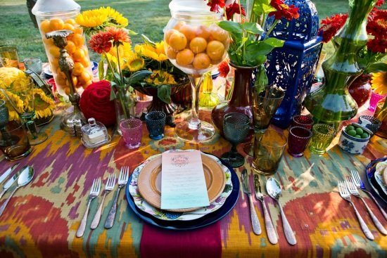 Tables dressed with splashes of bright colours and multi coloured glasses adds a touch of bohemian.
