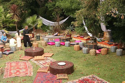 Morrocan inspired wedding with floor cushions and ottomans creating a relaxed and whimsical vibe.