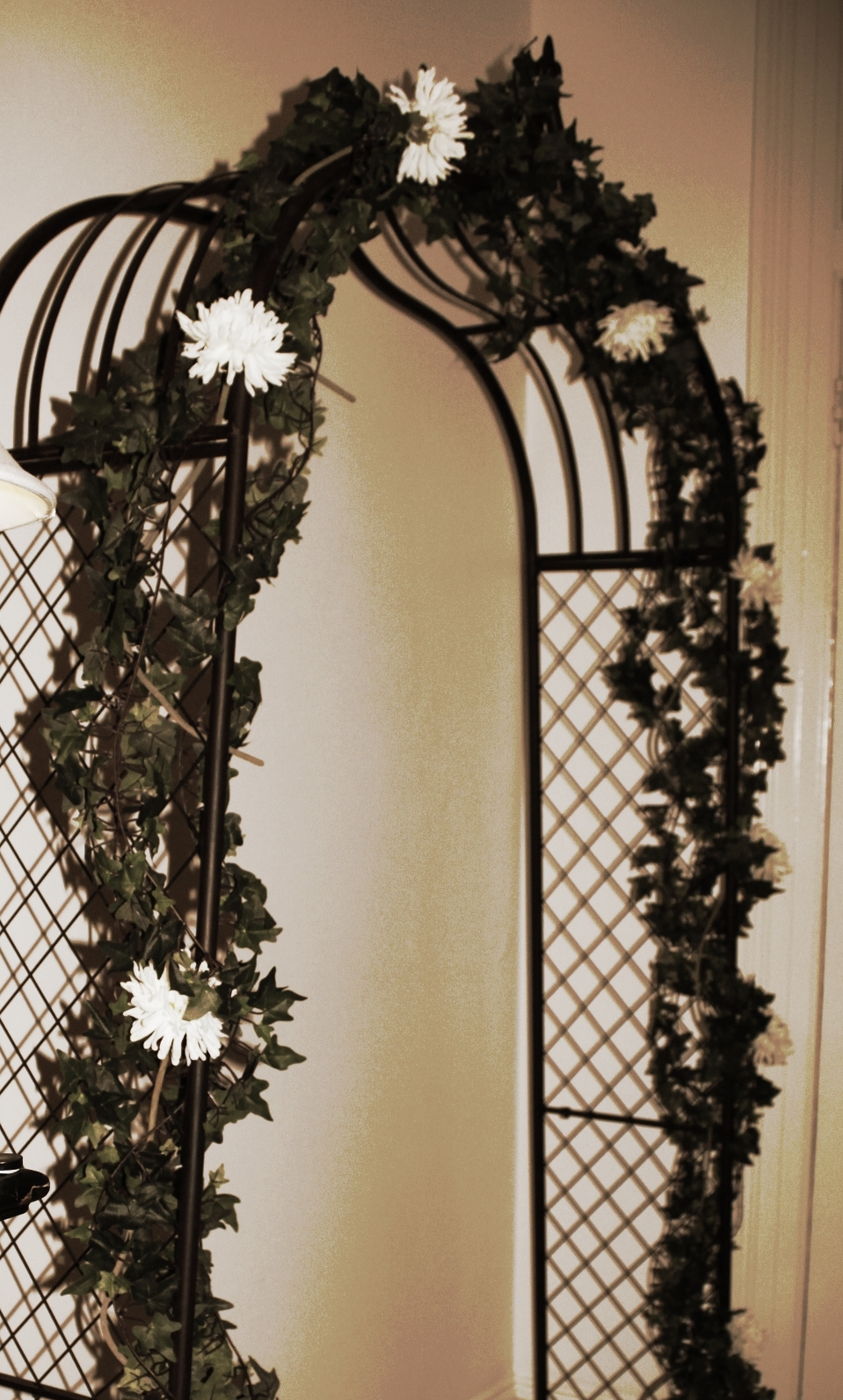 Rustic wedding arch with greenery
