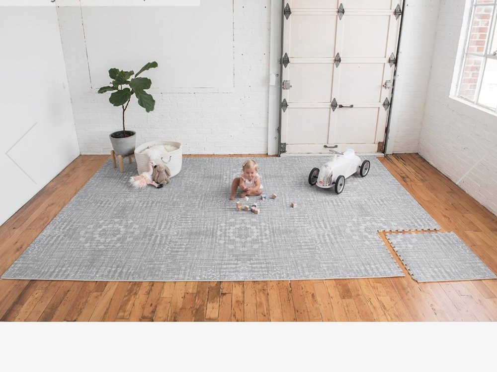 - Nomad has so many options of adorable yet pretty (read: no obnoxious colors here) play mats.Find them here.