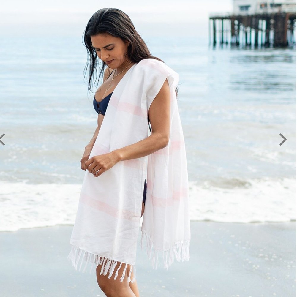 - The great thing about this lightweight towel is it's multi functional. Use it as a beach towel, wear it as a sarong, use it as a tablecloth too!Comes in a plethora of colors!Find it here.