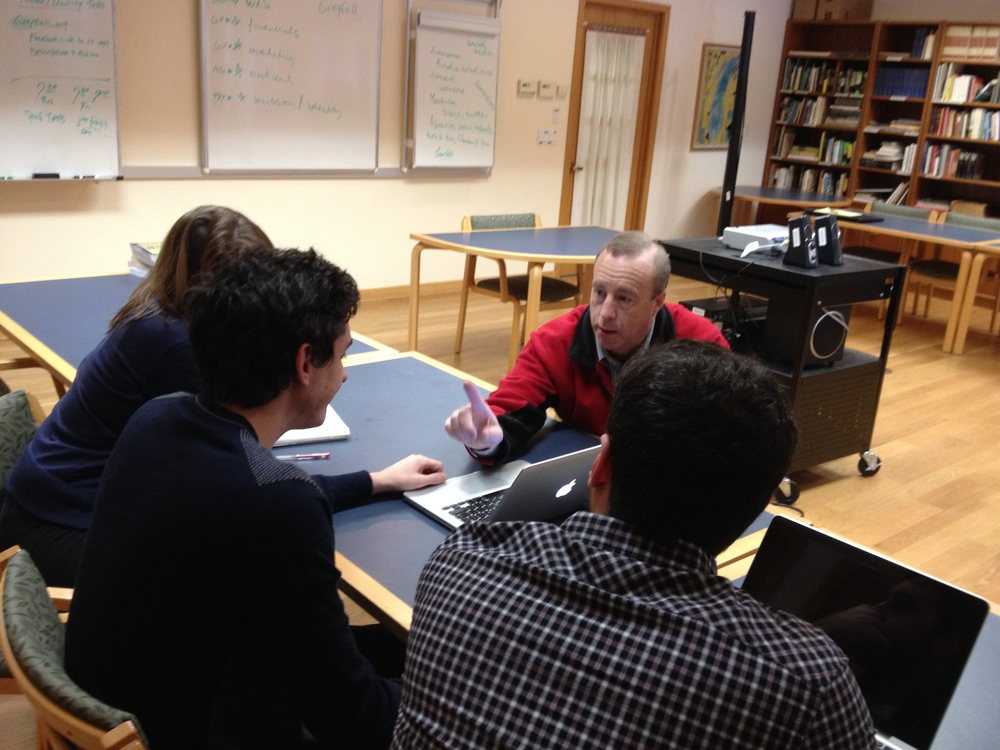 Students working with Professor Vaughan on marketing strategies.